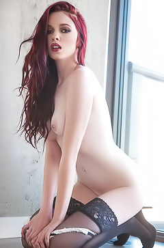 Red head babe Nico Faye