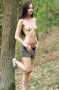 Vanessa is stripping in the forest