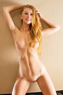 Racy redhead Helene struts around her apartment