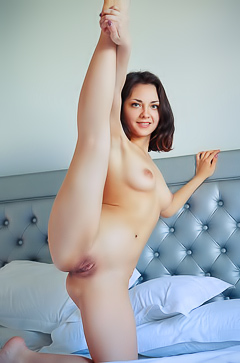 Lily White Flexible, fine brunette stretches out while nude