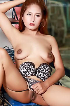 Redhead Asian Babe Gets Naked