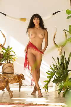 Erika De Leija gets naked among her houseplants
