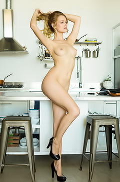 Olivia Preston cooks up something naked and hot in the kitchen