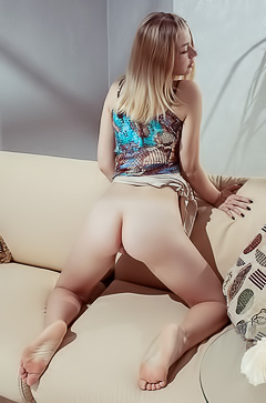 Blonde Daniel Sea rubs her curves on the couch