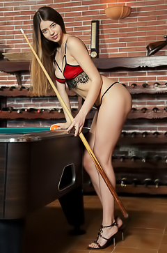 Stunning brunette Kay J has no problem putting you off your game when she bends over the pool table in sexy lingerie that shows